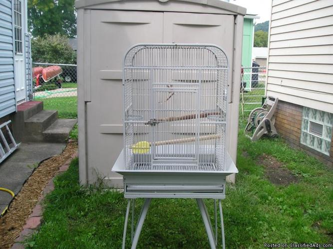 I have 2 medium bird cages and 1 canary cage to trade for a big cage - Price: trade