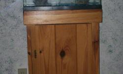 includes tank,nice wood stand, blue gravel, 2 decoration, filter, strip light