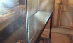 """50 gallon aquarium and metal stand and aquarium cover $125 or best offer. 4ft long, 1ft wide, 21"""" tall tank dimensions. Angle iron stand that is 29"""" tall that tank sits on. Springfield/Burke area."""