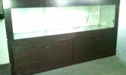 I have a 55 gallon aquarium with Dark Brown stained cabinet for sale. Absolutely no leaks! Cabinet measures approx. 1 1/2 ft deep, approx. 5ft wide and 3 ft tall. It comes with pump, filter, lights, PH meter, some decorative rocks and Mopani wood.
