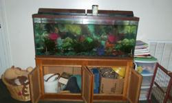 55 gallon fish tank with cabinet, a few fish, and lots of extra supplies displayed in the picture in the cabinet.  Feel free to call 318-473-4494 or email for more details or to schedule pick up as the water must be taken out before moving.