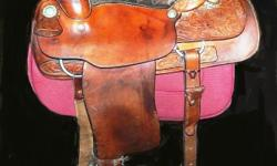 Big western saddle, true Long Horn brand, registered with number on it. 16 inch seat, wide tree, double skirted with tooled leather. 2 girths, one specially made tooled leather with knife or pick holder made into it.. Nice comfortable saddle for ranch,
