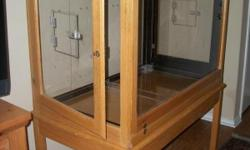 A beautiful large indoor oak, steel, and plexiglass aviary with some acessories. It is very heavy but can be taken apart to move if preferred. Each end opens completely and also has a small door that opens. The top has an open grate for plenty of air.