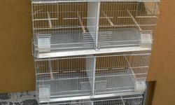 4 sets of breeding cages, thats 16 cages that will come 32 comes with perches, drinkers, feeders and custom dividers and stands with wheels almost new, only used for two months while builded the aviaries  $350.00 for all four sets