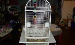 Bird Cage with 2 ceramic dishes, also the seed gaurds on all 4 sides, doesnt take up a lot of room perfect for cockatiel or smaller we used it for Indian Ring Neck