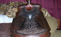"""VERY NICE 15"""" WEASTERN SADDLE. WELL CARED FOR. BEAUTIFUL CARVING. EX-PADDING IN FRONT OF THE HORN FOR THOSE FAST STOPS.double rig. this is a great saddle. NEED ANY HELP PLEASE CALL ME. I WILL SHIP. PAYPAL OR POSTAL MONEY ORDER S/H $ 50.00"""