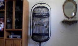 This is a cockatiel approx. four yrs. old and very friendly. It may take a few weeks for the bird to get used to you, as with any new pet. It comes with a very large rod iron bird cage and every thing you need for the bird. He very friendly and will