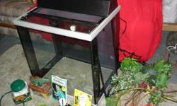 We have a very nice large 40 gall reptile cage we used for our Lizard. It has everything needed to start a new home. Branches, heater, plants, food, cricket box, food dish, etc. Both sides remove for easy cleaning and access. We are in Everett