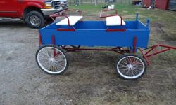 Pony cart that is lite enough to use as a mini cart for a team. Comes with a pony team pole. red white and blue. Very nice/NEW!