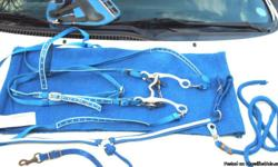 New, never once been on a horse, blue bridle with white hearts overlay. Matching reins ($25). Blue Chin Strap used (FREE with bridle). New Mayatex (with tags) royal blue Saddle Blanket ($20)..royal blue Stable Blanket ($20)...used twice royal blue leg