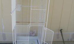Huge Wrought Iron Bird Cage measures 4 Feet Tall not measuring the tray with Wheels Nice Doors with Latches. All White Ready to go nice an Clean $75.00 Bring Exact dollar amount no change will be given 623-975-5956 Se Habla Espanol Location 47th ave one