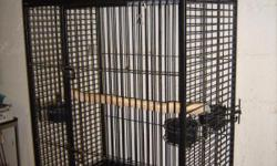 Large parrot cage for sale 36x47x24 deep , it is a black wrought iron is in very good condition. It has 3 feeding dishes and a slide out tray on the bottom for easy cleaning. It has a perch on top with rollers for easy moving.