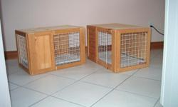 """Two pet cages at 20.00 each. They are 24""""wide x 16""""deep x 16""""high. Handy for trips in the car, or to the vet or just their own little house in your home. Made of wood and sliding wire doors. Bottom lined with removable carpet remnants, so soft and cozy."""
