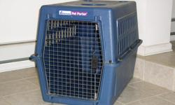 Heavy-duty plastic shell Wire doors Our dog is a German shepard/great dane cross and is now 65 pounds . She seemed to be more comfortable when she weighted 55 lbs. Great to clean, comes apart for easy access to inside. Must sell since since we are moving.