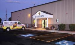 Premier Dog Training: Boom Towne Canine Campus offers Puppy and Adult Basic Obedience Classes; Agility Classes; Flyball; Competitive Obedience; Conformation Handling; Private Lessons; Boarding; Daycare; Grooming and a Dog Park.