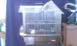 """Bird cage 171/2""""X13""""X20""""....comes with disabled parakeet."""