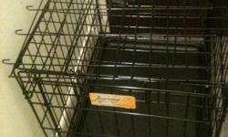 Small black wire crate. Excellent condition. Small dogs up to 20 lbs.