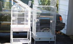 Two bird cages for sale. I am downsizing and need to sell these two. Both are cleand and come with stainless cups and a perch or two. Gray one is an older cage but in great condition. It is 24x24 and 53 inches tall from the floor. $70.00 White one is a
