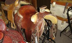 Billy Cook Mahogany Wade Saddle W/ Bucking rolls. Asking $1,199 Nobody builds em better than Billy Cook.  Trades welcome.   Hundreds of other saddles in stock, new & used. Come & see 'em. Riverside Boot & Saddle 742 W Hwy 39 Blackfoot, ID