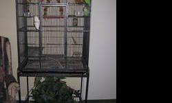 a cage on legs like the pictured one, with the bottom grate and seed/water dishes & at least a couple perches. I want it in beaver county because I need it brought to me in Beaver Falls.